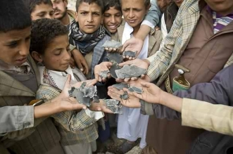 Yemeni boys display shrapnel they collected from the rubble of houses destroyed by Saudi-led airstrikes in a village near Sanaa, Yemen, Saturday, April 4, 2015. Since their advance began last year, the Shiite rebels, known as Houthis have overrun Yemen's capital, Sanaa, and several provinces, forcing the country's beleaguered President Abed Rabbo Mansour Hadi to flee the country. A Saudi-led coalition continued to carry out intensive airstrikes overnight and early Saturday morning targeting Houthi positions. (AP Photo/Hani Mohammed)